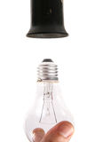 Changing the light bulb Royalty Free Stock Photos