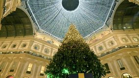 Changing lights on Christmas tree  under Galleria roof, Milan, Italy stock video
