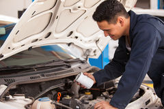 Changing the oil filter in a shop Royalty Free Stock Image