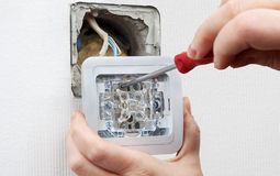 Changing room light switch installation with a screwdriver, clos Stock Images