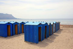 Changing rooms. A bright beach with several changing rooms on the sand Royalty Free Stock Images