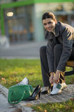 Changing shoes. Young business woman changing shoes Royalty Free Stock Photos
