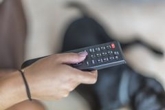 Changing television channel with remote control royalty free stock photography