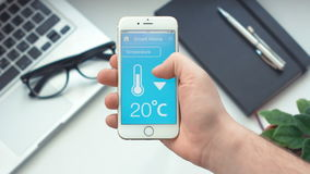 Changing temperature on smart home app on the smartphone stock footage