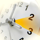 Changing time on the clock. Changing clock from wintertime to summertime Stock Photo