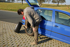 Changing a tire Royalty Free Stock Image