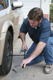 Changing Tire. A mechanic changing a tire Stock Photography