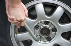 Changing a tire. At car Royalty Free Stock Photo