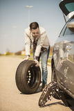 Changing tire on broken car on road Stock Image