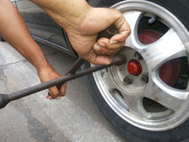 Changing a tire. Close up changing a tire on road Royalty Free Stock Photography