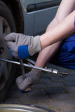 Changing a tire Stock Photo