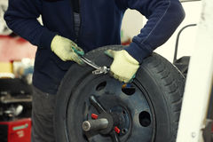 Changing a tire in a garage Stock Images