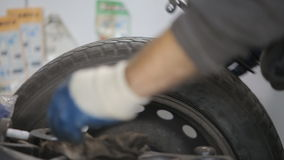Changing tire. Mechanic precision spin balance and installs a new tire on a car wheel rim stock footage