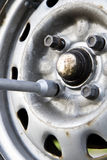 Changing tires and bolts. Manually changing tires for the summer season Royalty Free Stock Photo