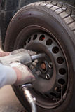 Changing the tires in the repair shop. Changing the wheels in an automobile repair shop Stock Photo