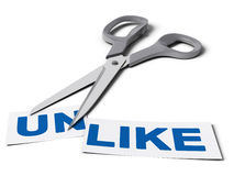 Changing Unlike Into Like, Improving Quality. Scissors cut the word unlike in two parts, the first one with the suffix un and the second one with the word like Royalty Free Stock Images