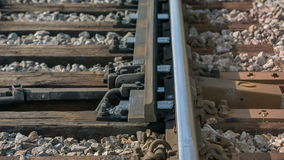 Changing the way at the rail rode. Close up RAW footage of a rail move and changing the way in the middle of a countryside on a sunny day stock footage