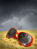 Beach and Sunglasses Overcast and Stormy Royalty Free Stock Images