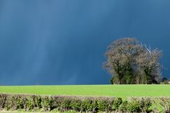 Dark clouds, storms and sunshine with changeable UK weather in early spring stock photos