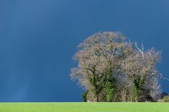 Dark clouds, storms and sunshine with changeable UK weather in early spring royalty free stock photography