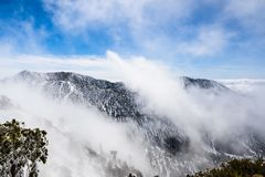 Changing weather with fog rising up from the valley, Mount San Antonio Mt Baldy, south California stock image