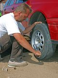 Changing the wheel 2 Stock Images