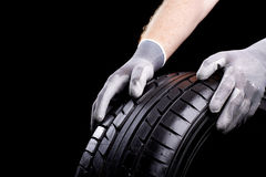 Changing a wheel. Car tires during service in the workshop stock image