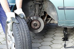 Changing a wheel Royalty Free Stock Photos