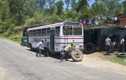 Changing a wheel on the Shuttle bus. Sri Lanka Royalty Free Stock Photography