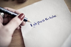 Changing the word impossible to possible Stock Images