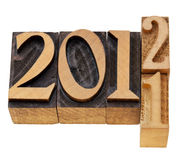 Changing years 2011 and 2012. Isolated numbered in vintage wood letterpress printing blocks Stock Photo