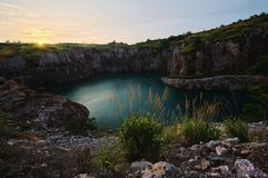 Changsha abandoned mine. Sunset, golden sun shining weeds here, here, it will be transformed into an ice rink Stock Image