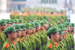 Male Chinese Students Military Training Formation. Changsha, China - September 5, 2007: Rows of male Chinese university students in communist green uniforms line Royalty Free Stock Photography
