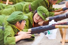 Chinese Student Military Training Uninterested. Changsha, China - September 5, 2007: A young relaxing Chinese female university student shows apathy and Royalty Free Stock Image