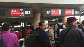 Changsha International Airport. Many people waiting for check-in at AirAsia counters in Changsha International Airport. Changsha Airport is the largest airport stock footage