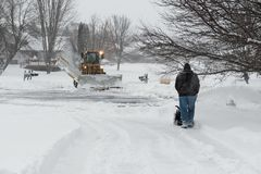 Homeowners Plow Driveways and City Plow on Street Stock Photos
