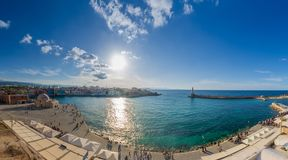 Chania with the amazing lighthouse, at sunset, Crete, Greece. royalty free stock photos