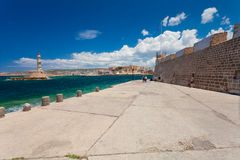 Chania, Crete, Greece  - 26 June, 2016:: People are walking on the embankment in the Old Town of Chania and Chania Lighthouse  Royalty Free Stock Images