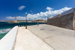 Chania, Crete, Greece - 26 June, 2016: View on the Embankment near the Old Town of Chania and Chania Lighthouse   Stock Photography