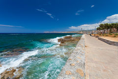 Chania, Crete, Greece  - 26 June, 2016:View on the Embankment near the Old Town of Chania and Chania Lighthouse   Stock Photo