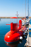 CHANIA, CRETE ISLAND, GREECE - JUNE 24, 2017: Red tourist semi-submarine at sea without capitan. Blue mediterranean sea in Crete,. CHANIA, CRETE ISLAND, GREECE Stock Images