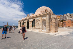 Chania, Crete - June 26, 2016: The Mosque Kioutsouk meaning little Hassan is located at the Venetian Port of Chania. Giali Tzamisi is located at the Venetian royalty free stock photo