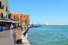 CHANIA, CRETE - September 09, 2013: View of embankment and lighthouse in Chania Old town, Greece. Royalty Free Stock Photos