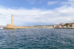 Chania Harbor Entrance. Chania, Greece - October 28, 2014: View of the entrance to the harbor of Chania with the Venetian or Egyptian lighthouse and part of the Stock Image