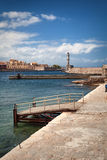 Chania harbor and lighthouse on Crete Island, Greece Stock Photos