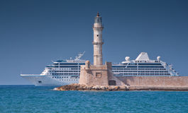 Chania lighthouse. Panoramic image of the Chania's lighthouse , Creete, Greece, with luxury cruise ship and blue sky background Stock Image