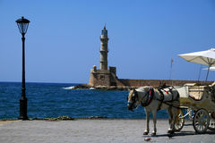 Chania lighthouse and horse-drawn carriage Stock Image