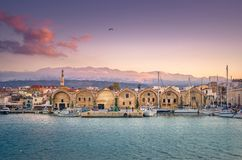 Chania with the amazing lighthouse, at sunset, Crete, Greece. Chania old harbor with the amazing lighthouse and mosque, Crete, Greece Stock Photo