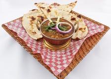 Channa-masala mit naan Stockfoto