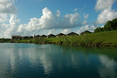 Beside channel. Resort in Riviera Maya, south Cancun, villas between the water of a channel and a golf course Stock Photos